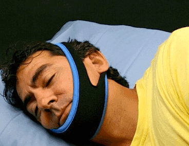 man wearing chin strap for snoring