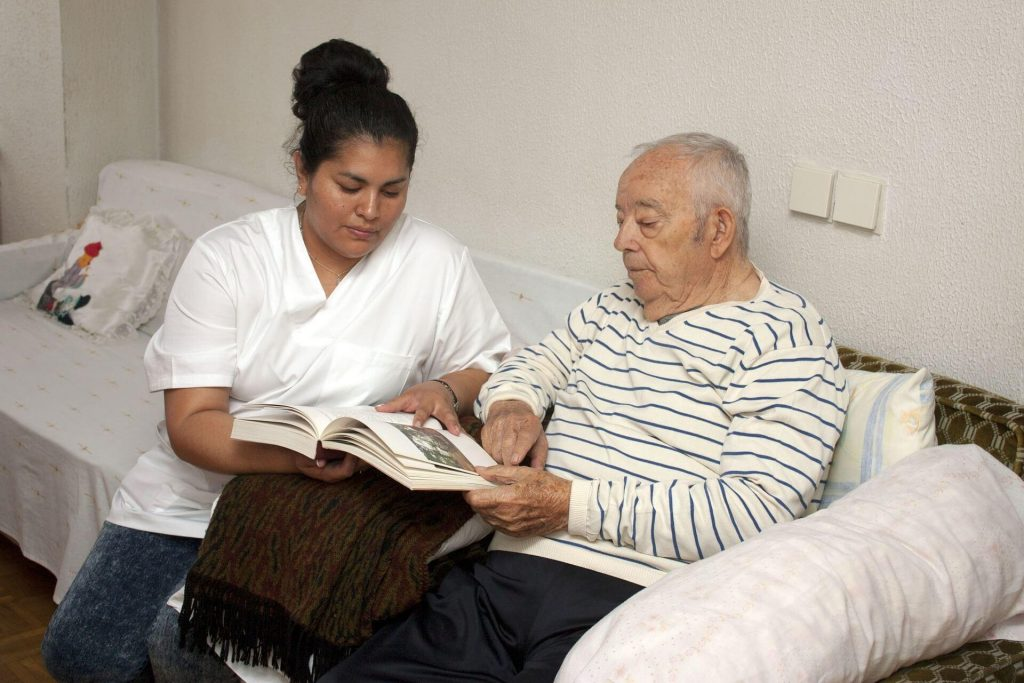 nurse helping Alzheimer's patient