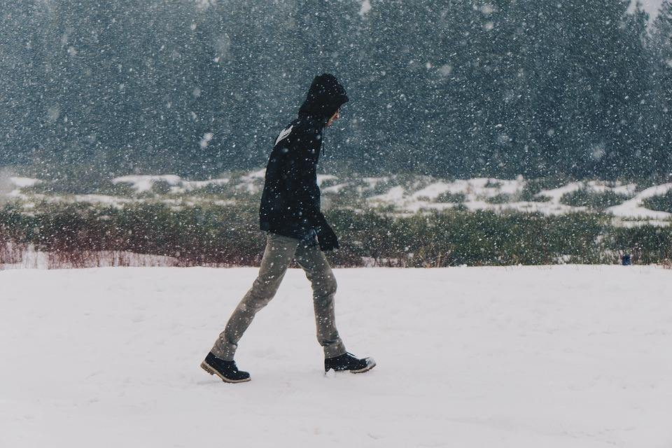 man walking in a snow storm