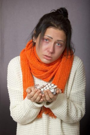 lady with a cold and medications