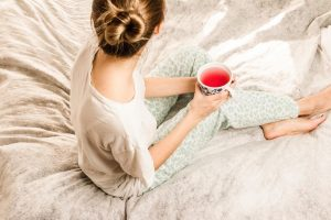 lady sitting in bed with tea