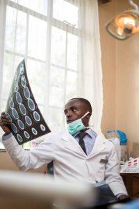 dentist examining an xray
