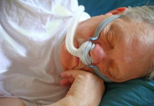 a man sleeping with cpap