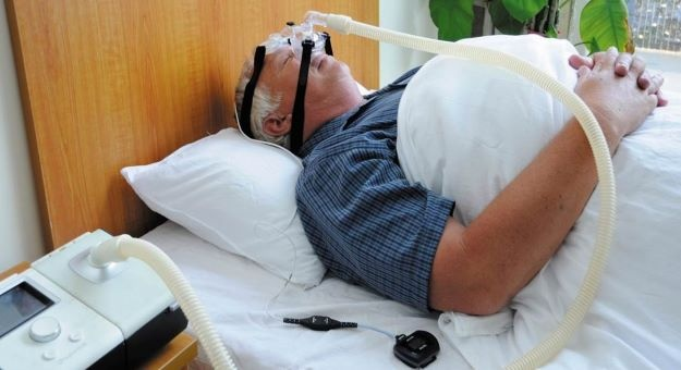 man wears cpap device